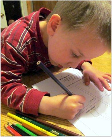 Little boy drawing stick figures on Grapevine Studies worksheet