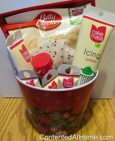 Basket filled with cookie mix, tubes of icing, and container of sprinkles
