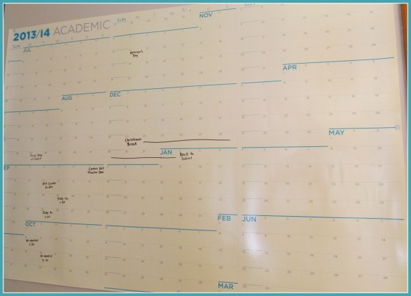 Large wall calendar with appointments filled in