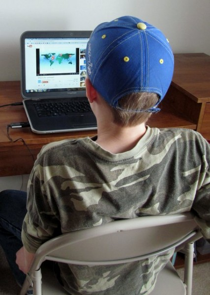 Boy using laptop to participate in online class