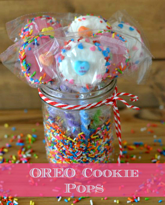 Colorful Oreo cookie pops in a glass jar filled with candy sprinkles
