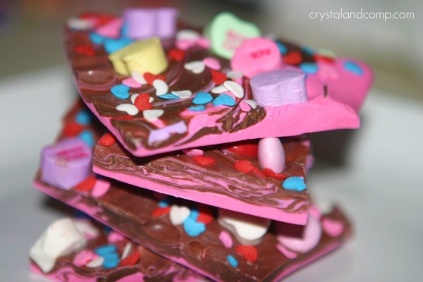 Stack of chocolate candy bark with Valentine heart candies