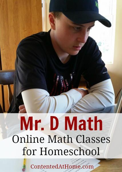 Teen boy doing homework on laptop