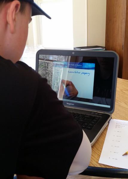 Boy watching math lesson video