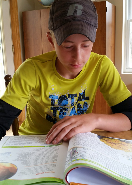 Boy reading science textbook