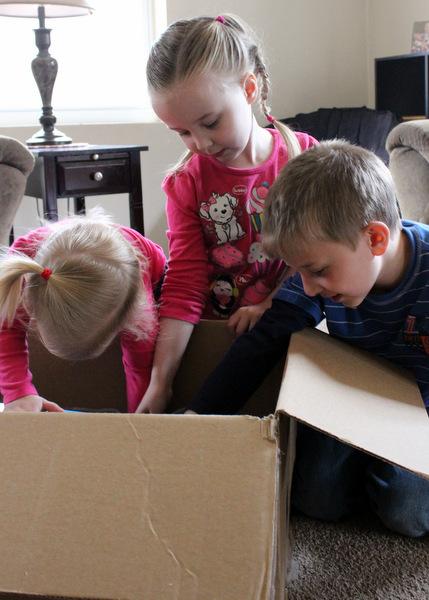 Kids unboxing new motorized fish toys