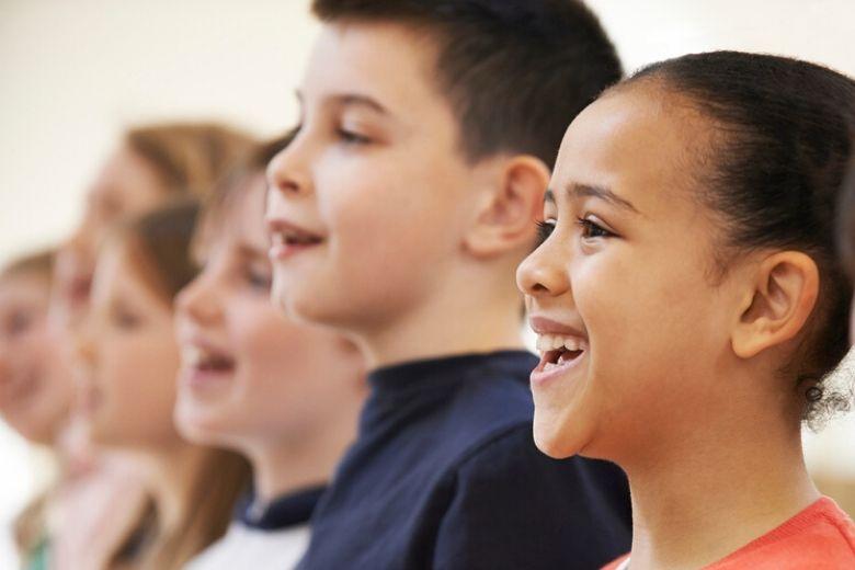 Smiling girl and boy singing
