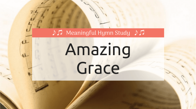 "Music pages folded to make a heart; text overlay that says ""Amazing Grace"""