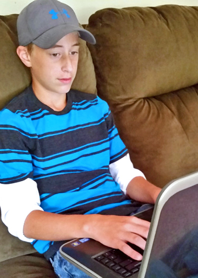 Boy doing a CTCMath lesson on a laptop