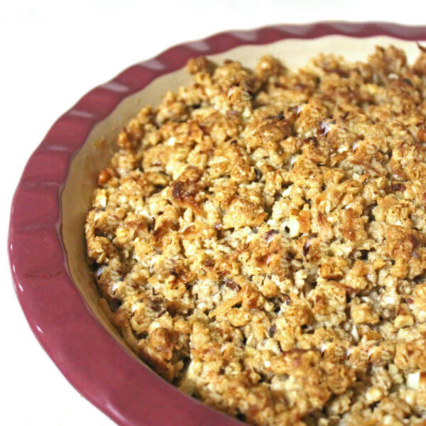 Apple crisp in a red baking dish