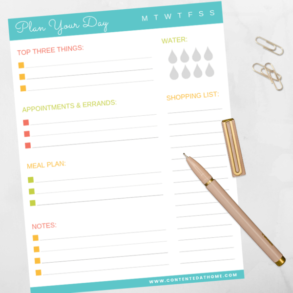 Printable planner with pen and paper clips on desk