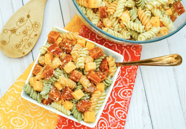 Bowl of Pasta Salad with Italian Dressing sitting on brightly colored napkins