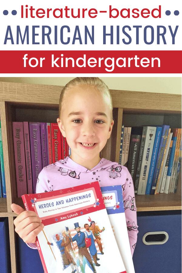 Smiling kindergarten girl holding American history books