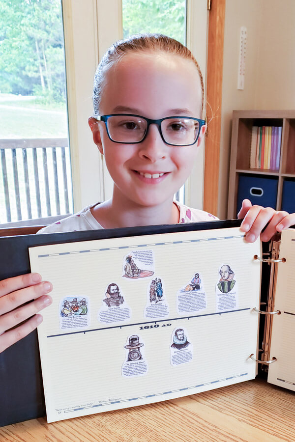 Smiling girl displaying her history timeline