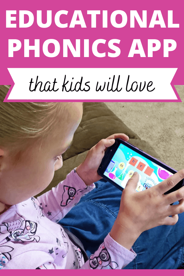 Little girl using educational phonics app on a smartphone