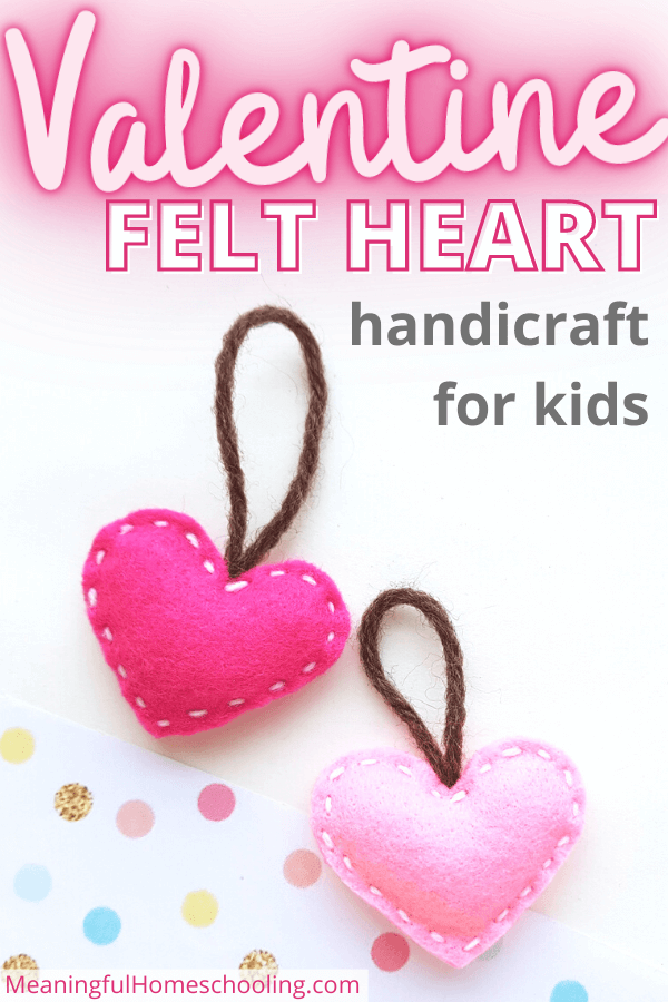 Stuffed pink felt hearts on a white background with dots