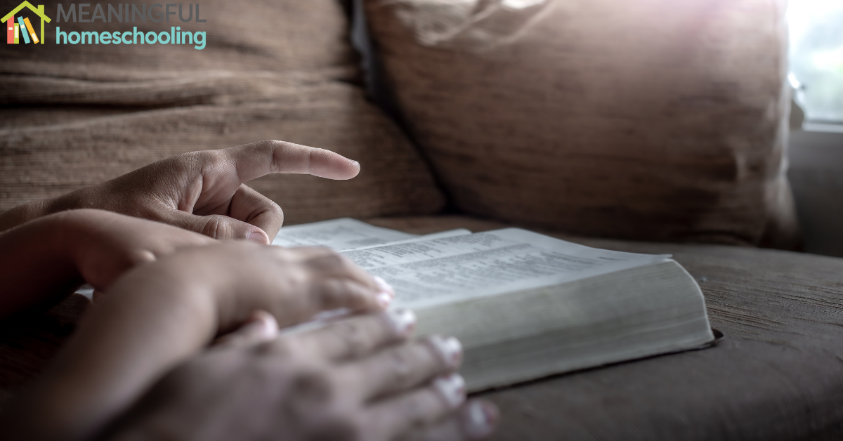 Hands placed on a Bible.