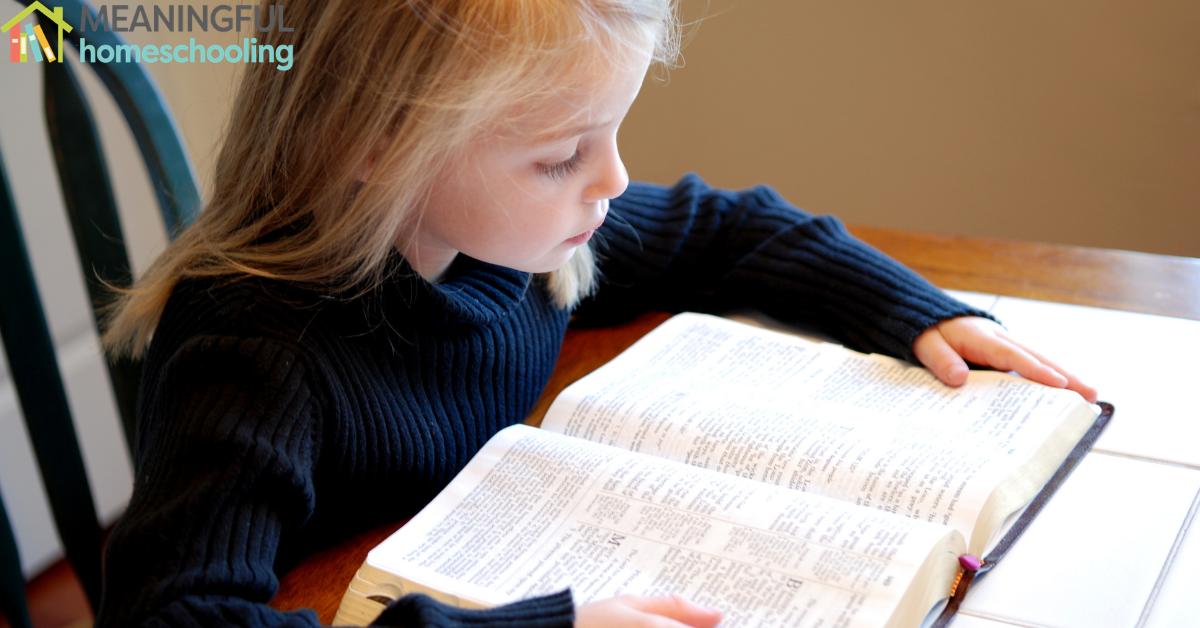 Little girl reading the Bible.