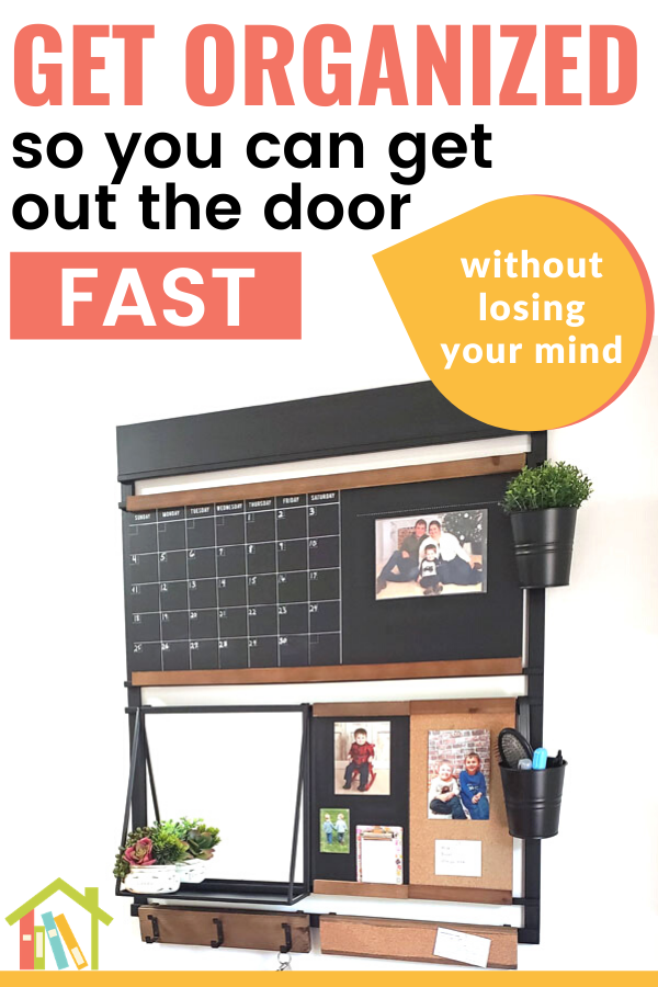 Wall organizer with mirror, blackboard, and corkboard on white wall