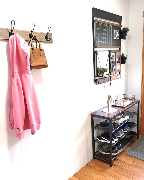 Entryway with coat rack, shoe rack, and wall organizer