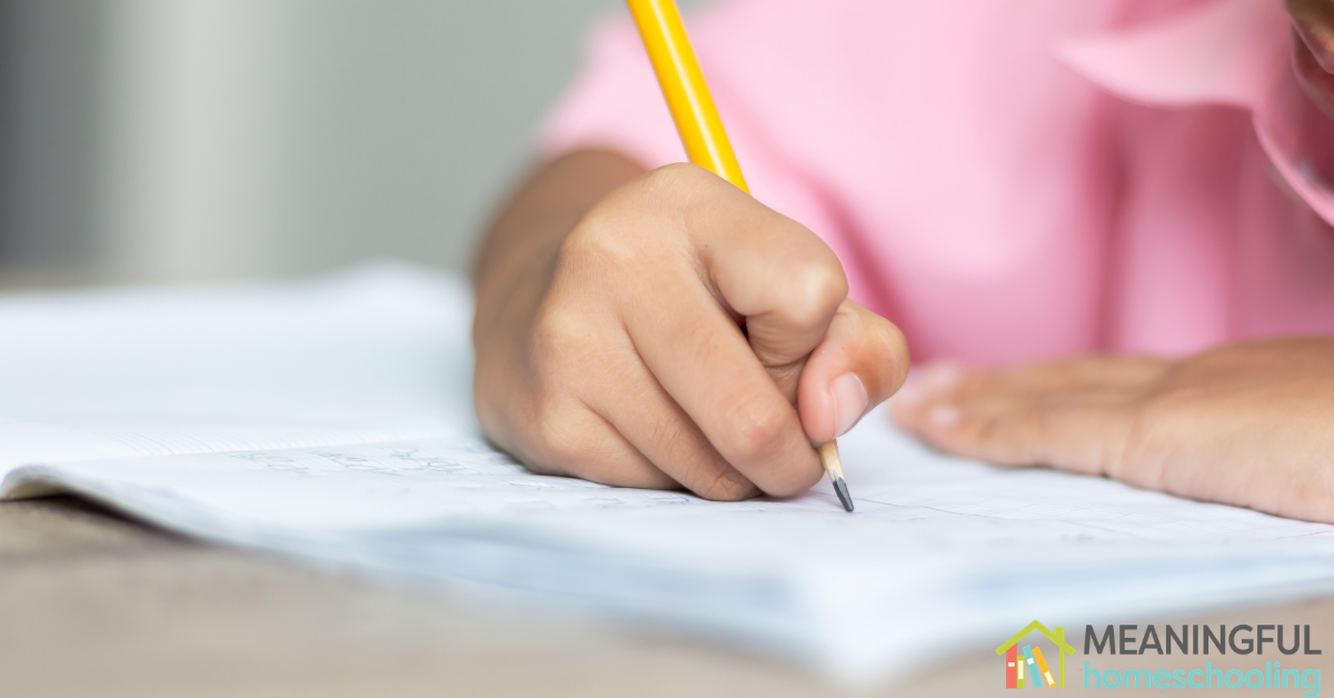 A child writing in his notebook.