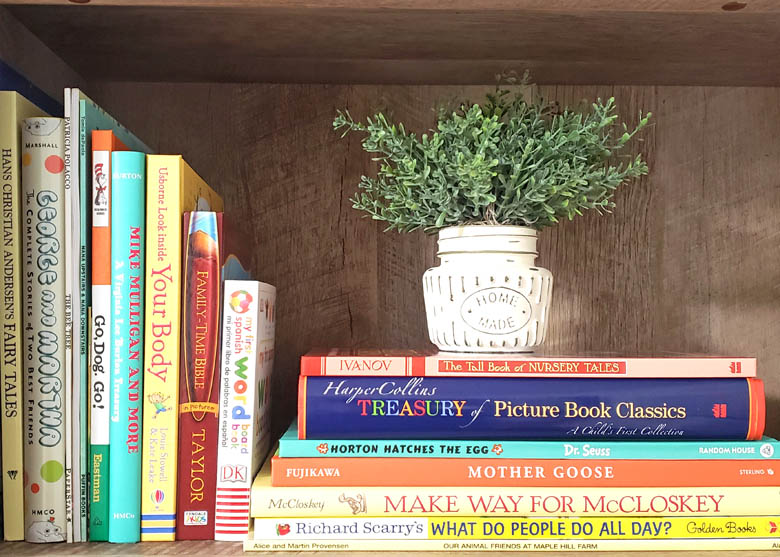 Classic children's books displayed on wooden shelf