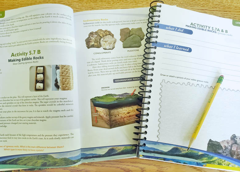 Homeschool earth science textbook and notebooking journal lying open on a table